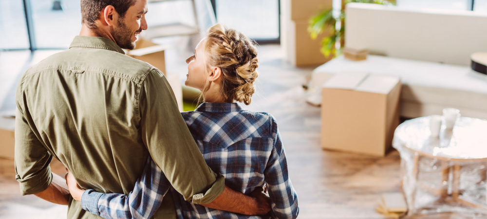 couple moving into new house because of First-Time Homebuyers' Loans