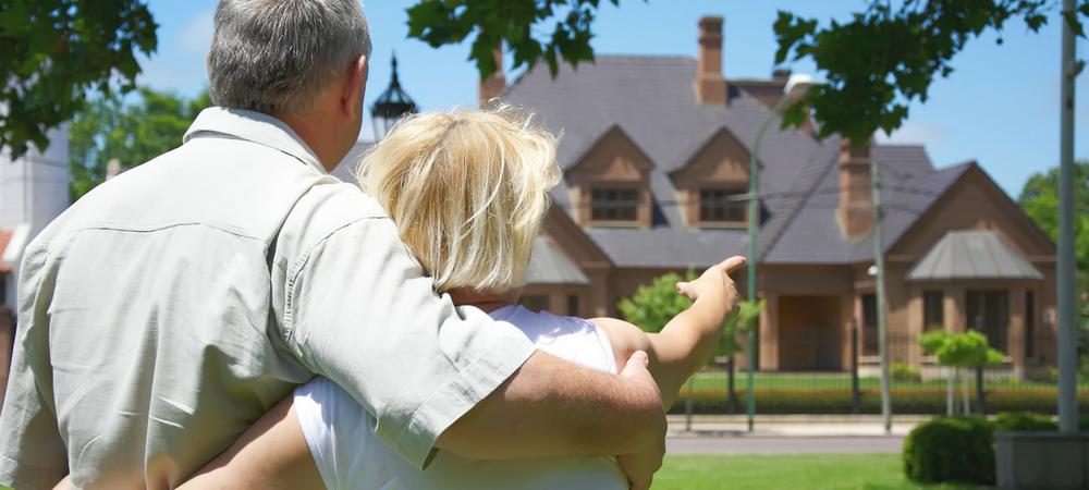 couple looking at house needing Jumbo Home Loans